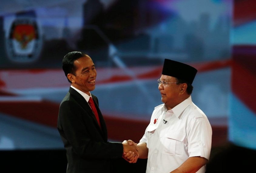 "Indonesia's presidential candidate Joko ""Jokowi"" Widodo shakes hands with his opponent Prabowo Subianto after a debate in Jakarta"